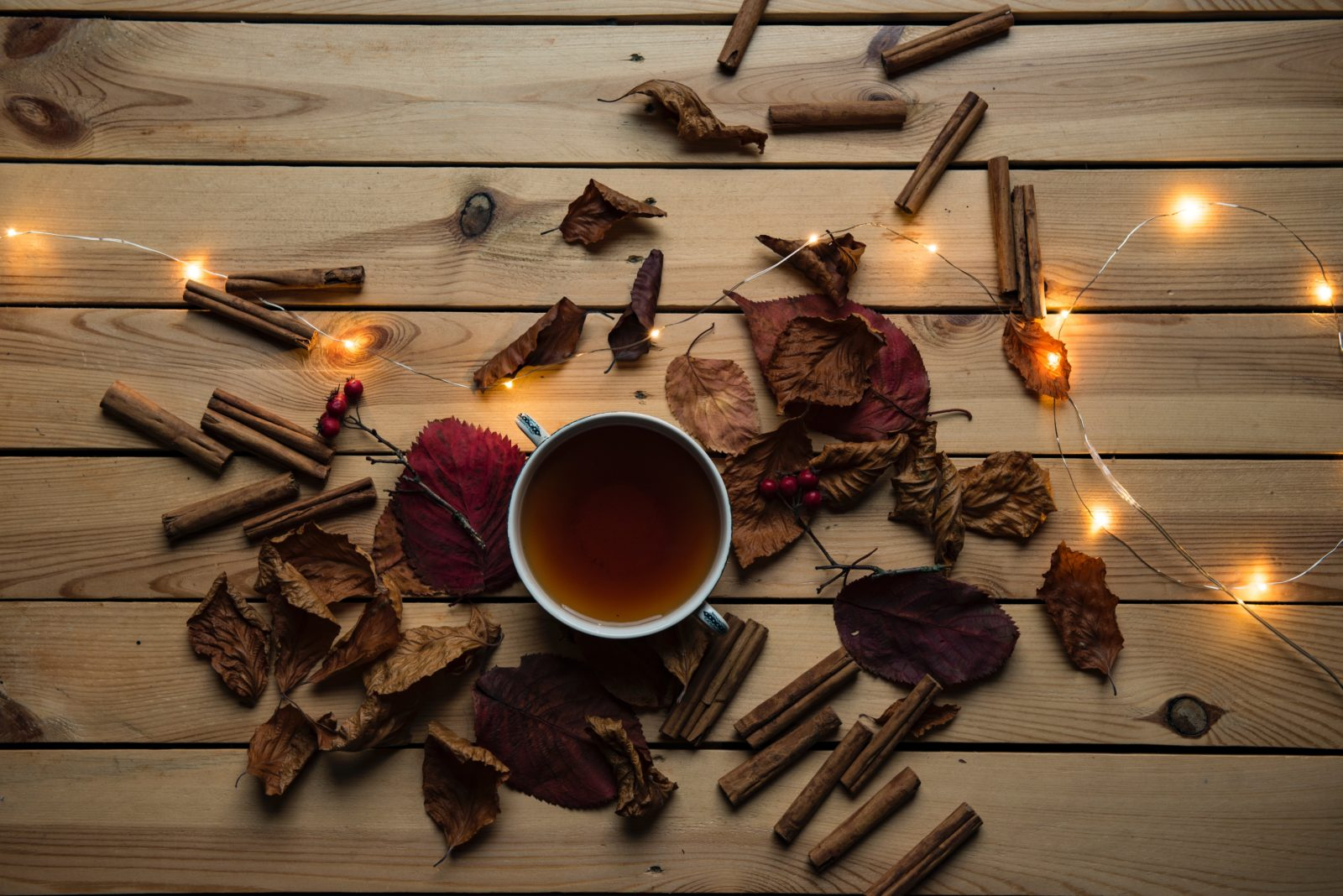 Oolong tea on a table with autumn leaves scattered around