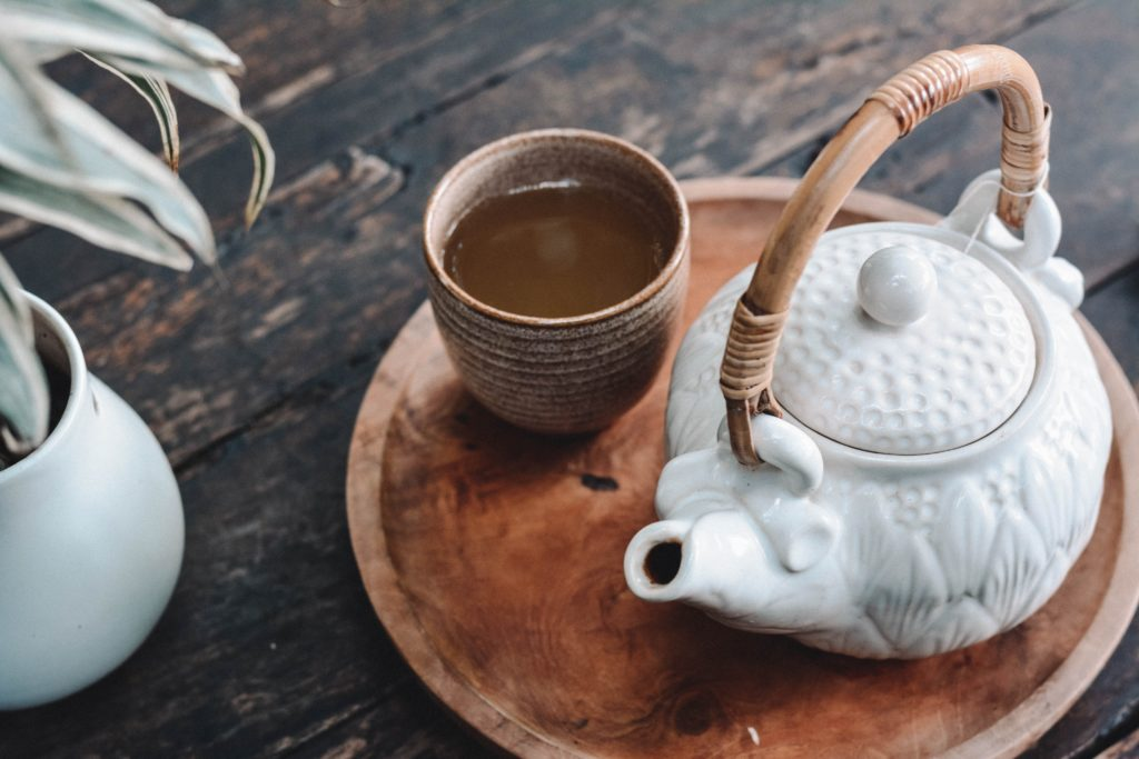 Loose leaf tea in a teapot, with a teacup. Loose leaf is better for flavor