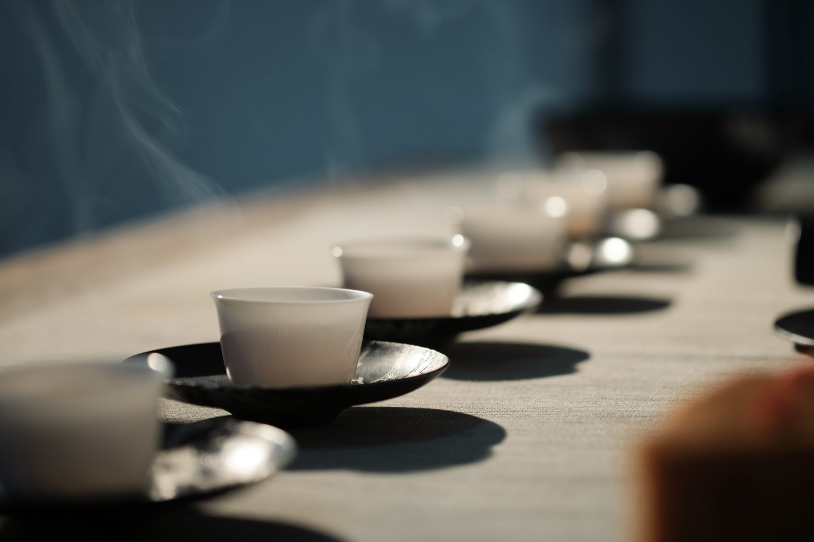 Gong fu tea service involves small cups like these, and small tea pots, and short brewing times.