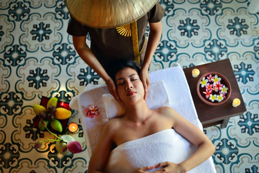 Woman getting facial in salon